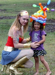 rainbow balloon hat and wonder woman